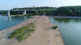 Drone flight over the river. Sand beach stock video