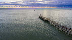 Drone flight over the sea pier with beacon Stock Photo