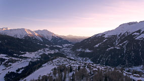 Drone Flight over a Snowy mountains. Drone Flight over a Snowy alpine mountains and rock faces and views over a Valley in the french alps Royalty Free Stock Images