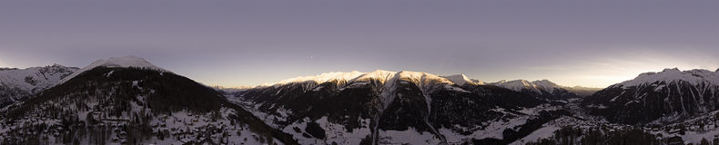 Drone Flight over a Snowy mountains. Drone Flight over a Snowy alpine mountains and rock faces and views over a Valley in the french alps Stock Photography