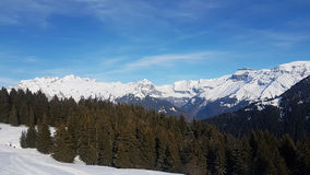 Drone Flight over a Snowy mountains. Drone Flight over a Snowy alpine mountains and rock faces and views over a Valley and Lake Geneva Stock Photos