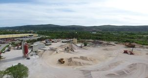 Drone flight over the territory of an concrete plant. Drone flight over the territory of an industrial enterprise, concrete plant for the production of building stock video