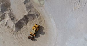 Drone flight over the territory of an concrete plant. Drone flight over the territory of an industrial enterprise, concrete plant for the production of building stock video footage