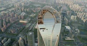 Drone flight over top of skyscraper under construction. Modern business building stock video
