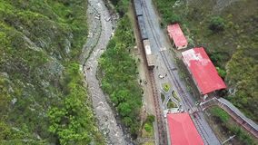 Drone flight over train arrival at the station Devil s Nose Ecuador. Daytime stock video