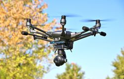 DRONE In Flight - Professional High Tech Camera UAV / UAS Stock Photography