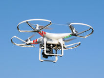 Drone in flight. Drone quadcopter with digital camera in flight Stock Photo