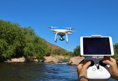 Drone In Flight with Radio (Blank Screen for Text) Stock Photography