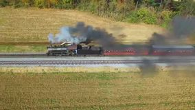 Drone Flight of a Steam Engine and Train Pulling out of a Station in Pennsylvania USA. Drone Flight of a Steam Engine and Train Blowing Smoke in Pennsylvania stock video footage