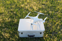 Drone before the flight on a transport metal bag. KAGAWA, JAPAN - APRIL 23, 2017: White drone Dji Phantom4Pro stay on metal bag and ready to fly Stock Photo