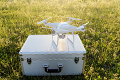 Drone before the flight on a transport metal bag. KAGAWA, JAPAN - APRIL 23, 2017: White drone Dji Phantom4Pro stay on metal bag and ready to fly Stock Photos