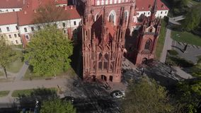 4k aerial view of gothic architecture heritage St. Anne`s church in Vilnius, Lithuania stock footage