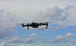 Drone on fly. Drone flying in a blue sky stock photo