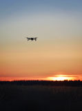 Drone on fly. Drone flying in a dusk royalty free stock photos