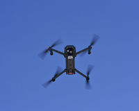 Drone on fly. Drone flying in a dusk royalty free stock image