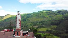 Drone fly over Devil s Nose valley and San Pedro viewpoint Alausi Ecuador. Ecuador May 2018 Drone flight over San Pedro Statue. Patron saint of the city, built stock video footage