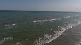 Drone flying above the sea and shore. Drone rises up above the ocean, Black Sea, Romania stock video