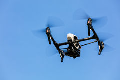 Drone flying against blue sky background Royalty Free Stock Photography