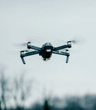 Drone Flying Against Sky Stock Photos