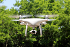 Drone flying in air and blue sky in the forest stock image