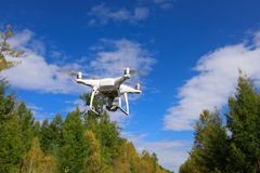 Drone flying in the air. One drone flying in the air over autumn forest royalty free stock images
