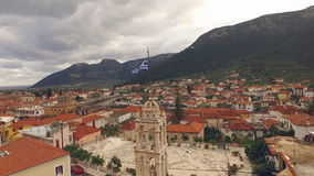 Drone is flying around the bell tower in the Greek city of Leonio stock video