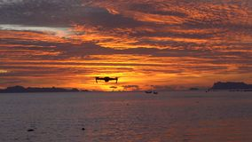 Drone Flying Away at Sunset Above the Sea stock footage