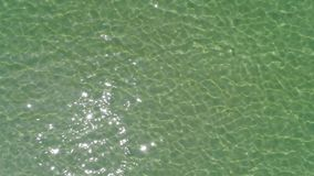 Drone flying beautiful sea water surface. Aerial view, top view, drone flying beautiful sea water surface, sunlight reflecting stock footage
