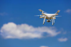 Drone flying on the blue sky Royalty Free Stock Photo
