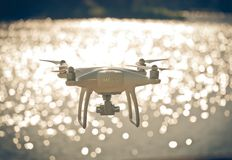 Drone flying. On bokeh water reflection Stock Images