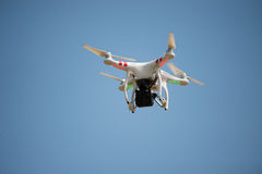 Drone Flying Carrying Camera Stock Images