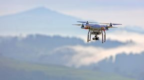 Drone flying in cloudy skies Royalty Free Stock Images