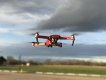 Drone flying in cloudy skies Royalty Free Stock Photo