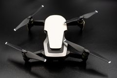 Drone - Flying in the dark, on black background. Closeup on dark. Portable drones, View on the drones gimbal and camera royalty free stock image