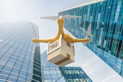 Drone flying with a delivery box package in a city Stock Photo