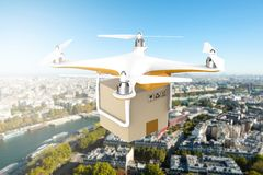 Drone flying with a delivery box package Stock Photo
