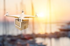 Drone flying with a delivery box package in an harbour Stock Images
