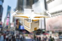 Drone flying with a delivery box package in a modern city Stock Photos