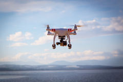 Drone flying. Modern drone flying high in the good weather royalty free stock photos
