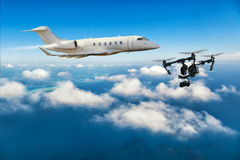 Drone flying near commercial airplane Royalty Free Stock Photography