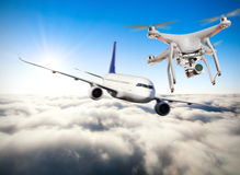 Drone flying near commercial airplane Royalty Free Stock Images