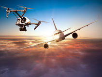 Drone flying near commercial airplane Stock Image