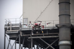 Drone is flying near an industry. A drone is flying vertically, an industry in the background Stock Photography