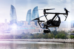 Drone flying over Baku city. On blurred background Royalty Free Stock Images