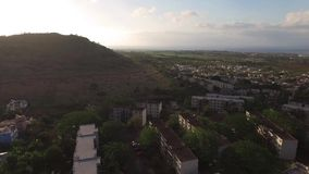 Drone flying over the Belle Etoile town in Mauritius, close to Port Louis. Stormy Sky and mountain in Background stock video