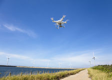 Drone flying over the blue sky. With wind turbine Royalty Free Stock Photography