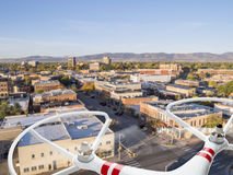 Drone flying over city. Street - privacy invasion or safety issues concept royalty free stock image