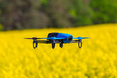 Drone flying over the field. Drone flying over blossom rapeseed field Stock Photography