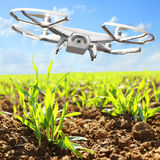 Drone flying over field. royalty free stock image