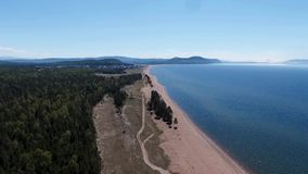 Drone flying over the forest near Lake Baikal, Buryatia, Russia stock footage